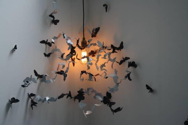 Moths around a lightbulb