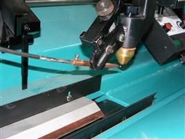 Auto lift seam welder
