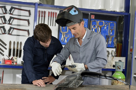 Tom, welding instructor with student Paul