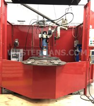 OTC Model D series robot with twin station indexing tables all built on an easily movable welding robot cell  Year 2001